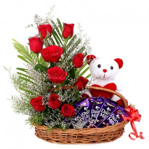 Flower branches with deddy ,chocolates in baskets Delivery in Ajmer