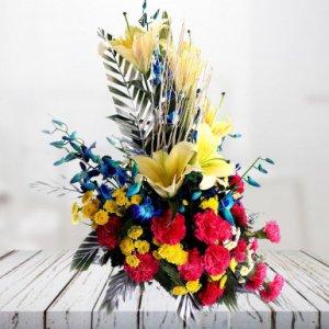 orchid and mix flower arrangement