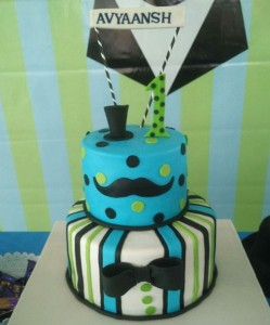 Little man themed cake