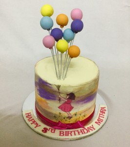 Girl holding balloon- Buttercream Birthday cake