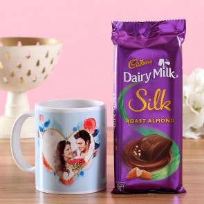 Product DetailProduct Details :One Cadbury Dairy Milk Silk Roast Almond Chocolate Bar- 137 gmsOne Personalised Ceramic MugDimensions- Height: 4 inches & Diameter: 3 inchesCapacity- Can hold liquid upto 325 mlMicrowave and dishwasher safeFor personalisation, please provide us with 1 image.