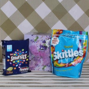 Product Detail Skittles Pack ( Weight : 180 Gms ), along with Imported Nestle Smarties pack ( Weight : 152 Gms ) in a Gift Box.(Box Designer and color may vary).